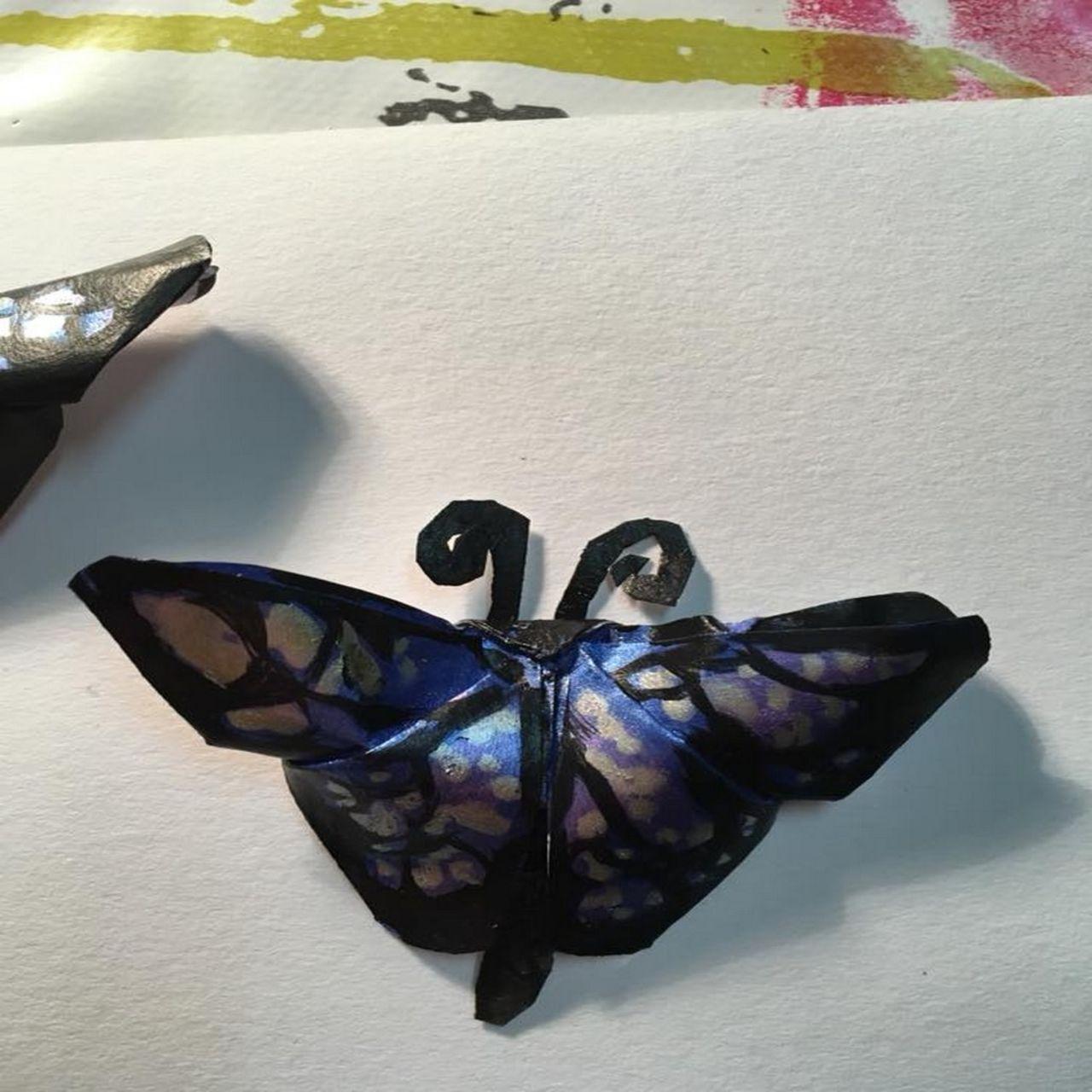 cué papillon bleu